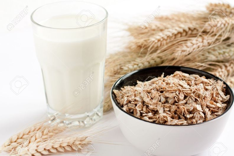 14274627-Glass-of-milk-and-oatmeal-Ears-of-wheat-in-the-background-Stock-Photo.jpg